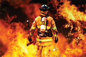 2012-11and12-tt-03-ia-to-the-fire-a-firefighter-searches-for-possible-survivors-300x200